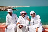 young male locals with their typical traditional arabic dress Kandora or Dishdasha, Abu Dhabi, capital city of the United Arab Emirates UAE, Asia