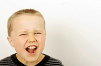 Stock Photo of a young boy shouting