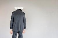 Businessman left behind on a coat hanger