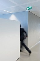 Businessman rushing towards the exit door