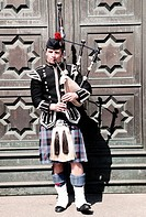 Scottish guy playing the bagpipes.