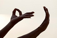 Detail of female forming Mudra hand gesture used in yoga practice meditation