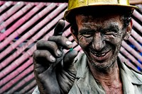 A miner shows a rough emerald found in the mine of Muzo, Colombia, 21 April 2006  Despite of a persisting civil war conflict and related difficulties ...