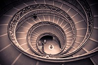 Spiral staircase by Giuseppe Momo leading to main floor of Vatican Museum, Rome, Italy