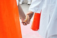 White Peace and Orange Success Holdiang theirs Hand ,Poona,Maharashtra,India