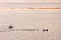 Two fishing boats in Santander´s bay at sunshine, Cantabria, Spain