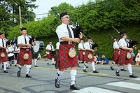 A Scotish Highland bagpipe band on parade during the Comox Aquatic Days festival