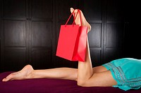 shopping bag holding by woman finger foot