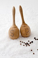 Salt and pepper wooden shakers on salt and pepper balls