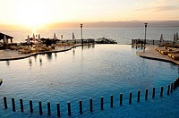 Swimming pool at sunset, Kempinski Hotel, Dead Sea, Jordan, Middle East.