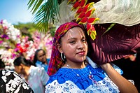 Salvadoran girls carry an altar with a statue of Virgin Mary during the procession of the Flower & Palm Festival in Panchimalco, El Salvador, 8 May 20...