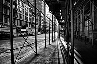 Shadows under some scaffolding on a street in New York