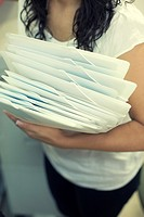 Girl working in an office with white folders