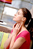 Young woman having a sorethroat