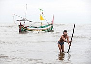 fisherman working in the sea of java, indonesia