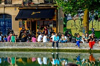 Paris, France, Young People Relaxing in Front of French Bar Bistro Restaurant, ´Marcel´ the Canal Saint Martin Area