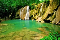 Waterfall and idyllic emerald pond in Turuépano National Park, Eastern Venezuela