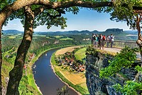 View from the spectacular rock formation Bastei Bastion to health resort Rathen and the Elbe River The Bastei is one of the most visited tourist attra...