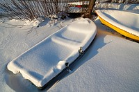 Rowboat filled with snow and stuck into ice  Location Oulu Finland Scandinavia Europe