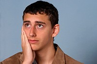 Worried look on face of young teenage man