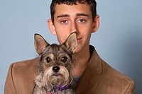 Funny portrait of dog and young teenage man