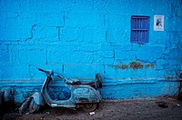Old Vespa motorbike parked in front of a blue painted wall  Jodhpur, Rajasthan, India