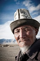 Portrait of a old Kyrgyz Man with traditional hat Kalpak, Karakul, Tajikistan