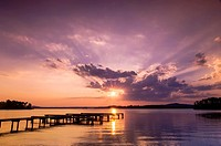 Sunset over a lake with a small boat dock silhouetted in the foreground, Lake Guntersville State Park, Alabama, USA.