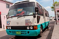 A jitney bus waits for passengers in downtown Nassau, Bahamas