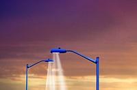 Two modern steel streetlamps