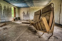 Abandoned house interior with old couch