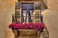 Old balcony with red flowers