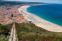 Elevador, Ascensor da Nazare, Funicular railway and Beach, Praia, seen from Sitio, old village, Nazare, Oeste, Leiria District, Portugal.
