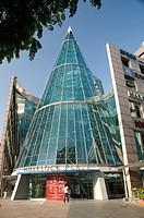 Glass cone atrium of mall in Singapore
