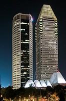 City view of downtown office building at night in Singapore