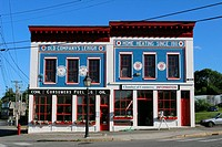 Belfast, Maine, New England, USA, building facade, coal, and oil, company, red, white, blue.