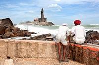 Kanyakumari, India-September 9, 2012  Two Hindu pilgrims watching the horizon at Cape Comorin, where the Vivekananda memorial welcoming hundreds of pi...