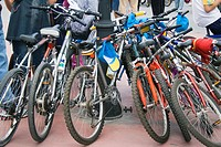 Many bicycles parked around lampost. Torremolinos, Malaga, Sapin