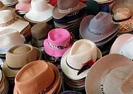 Hats merchant Na Phra Lan road Market Bangkok Thailand.