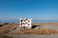 Italy, Calabria  Strange lone apartment building near the shre of the Tyrrhenian Sea
