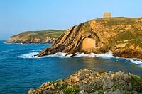 The small Santa Justa Chapel, embedded into the cliff  Santa Justa beach, Ubiarco village  Santillana del Mar  Cantabria  Spain
