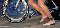 Triathlon competitor prepares to mount his bike