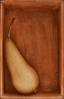 A pear in a wooden box