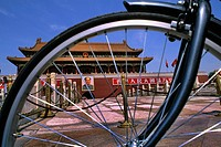 Graphic image of bike and Mao portrait at Heavenly Gate in Beijing China.