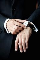 Man touching his watch