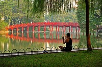 early morning exercises beside Hoan Kiem Lake, Hanoi, Vietnam