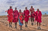 Kenya Africa Amboseli Masai men in red costume dress and beads in Amboseli National Park safari 1