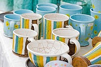 Cheery handcrafted ceramic striped cups and saucers  Cheery colors of gold, blck, blue and green make attractive casual dinnerware  Handcrafted cerami...