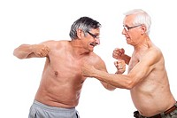 Two naked senior men fighting, isolated on white background