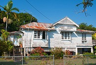 A old-fashioned Queenslander home raised on stilts, in tropical Cairns, North Queensland